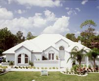 A house with a white cool roof.