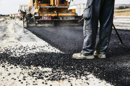 Road construction with fresh asphalt (Credit: wabeno/iStock)